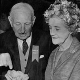 Professor E.G. Waterhouse showing Dame Pattie Menzies the finer points of a camellia bloom  in 1964.