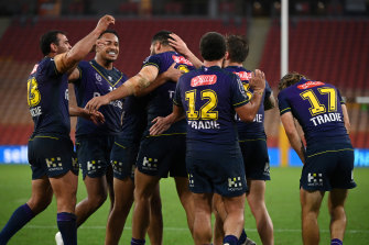 Storm players celebrate a Jesse Bromwich try in the 27-point demolition of Penrith.