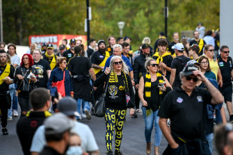 Fans enter the MCG during round one to watch live AFL for the first time in more than 500 days.