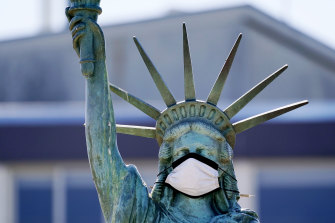 A face mask has been placed on a replica of the Statue of Liberty in Seattle.