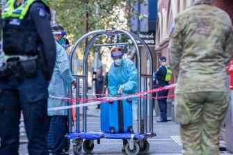 Hotel quarantine staff help newly returned travellers settle in.