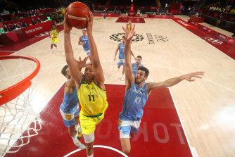 Australia's Dante Exum goes up for a dunk.