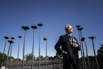 Korea War veteran Nak Yoon Paik among 136 steel and bronze flowers, based on the Rose of Sharon, the national flower of South Korea, that represent the fallen troops from NSW.