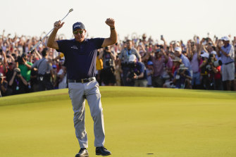Phil Mickelson celebrates his historic win.
