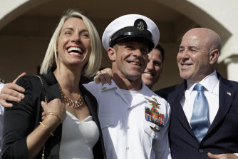 Chief Petty Officer Edward Gallagher, centre, with his wife Andrea and wearing his Trident pin as they leave a military court on Naval Base San Diego after his acquittal on all but one charge in July.