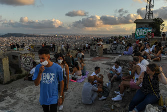 Locals enjoy the view over Barcelona one day after the Catalan government issued new recommendations to fight COVID-19.