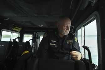 Australian Border Force (ABF) regional commander of Northern command Colin Drysdale on a fast response boat patrolling off Thursday Island.