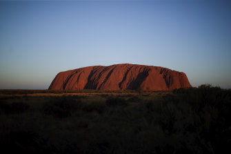 Sunset at Uluru on Saturday after its permanent closure to climbers.