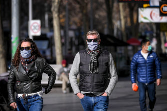 People in Melbourne CBD wearing face masks on Wednesday, a day before they became mandatory.