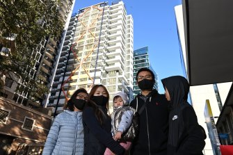 Ben Xue, second from right, and his family outside the Imperial towers.
