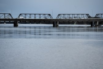 Floodwaters beneath the Nowra Bridge over the Shoalhaven River.