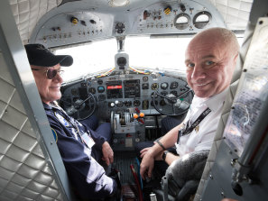 Mike Falls, left, and his son, Mike Falls jnr, owners of Shortstop Jet Charter in the cockpit of their DC-3 'Gooney Bird' airliner that dates from 1945.