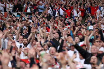Happy England fans ahead of Sunday's final at Wembley Stadium.