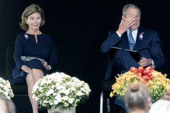 Former President George W. Bush, right, wipes his eyes next to former first lady Laura Bush, after he spoke at a memorial for the passengers and crew of United Flight 93 on September 11, 2021.