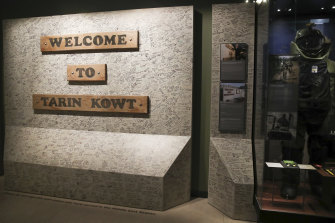 The Afghanistan exhibition at the Australian War Memorial includes a wall signed by thousands of veterans who served in Tarin Kowt.