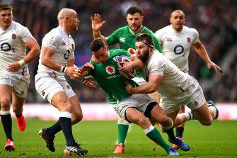 England's Luke Cowan-Dickie and Willi Heinz pull Ireland's John Cooney to the ground.