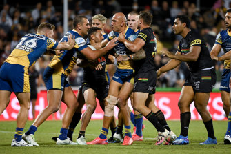 Blake Ferguson squabbles with Penrith players after he was accused of milking a penalty.