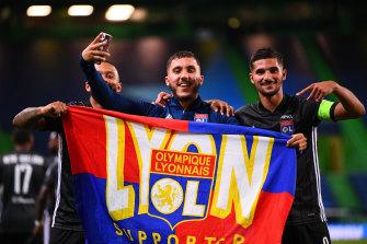 Memphis Depay, Rayan Cherki and Houssem Aouar celebrate Lyon's success.