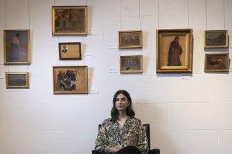 Leonard Joel's head of art Olivia Fuller with paintings by Ethel Carrick Fox and Emanuel Phillips Fox.