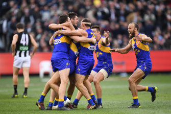 Shannon Hurn, centre, celebrates with teammate Jeremy McGovern, Tom Barrass, Tom Cole, Elliot Yeo and Will Schofield after winning the 2018 grand final.