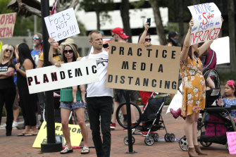 Social media is the prefect place to share conspiracy theories and suspicions. Here, supporters of then president Donald Trump bringing some resistance to scientific thinking out of the internet in Florida.