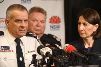 Rob Rogers (left) has won the support of Premier Gladys Berejiklian  (right) and her cabinet to remain in the job as Rural Fire Service commissioner beyond his one-year appointment.