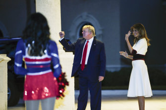 US President Donald Trump and first lady Melania Trump watch as the Florida Atlantic University Marching Band performs during a Super Bowl party at the Trump International Golf Club in West Palm Beach.
