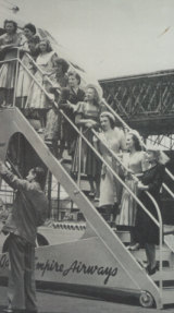 The first intake of nine Qantas flight hostesses study the exterior structure of the Lockheed Constellation 749, February 1948. Patricia Burke, second from top.