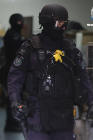 NSW Police raiding a property as part of the strike force investigation.