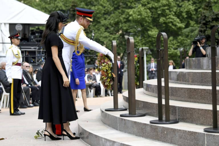 Prince Harry, and his wife Meghan, the Duchess of Sussex, lay a wreath at the official opening of Anzac Memorial at Hyde Park.
