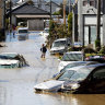 Japan typhoon death toll climbs, while floodwaters recede