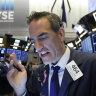 Wall Street hits record after strong jobs data
