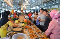 People shop at a local market in Bandar Seri Begawan, Brunei's capital. Restrictions and protocols including mask wearing have now been re-imposed.