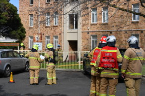 A child has died after a fire at a low-rise housing commission building on Saturday.