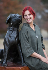 Designer Amanda Gibson with sculpture of Justin the tracker dog at Greensborough War Memorial Park.