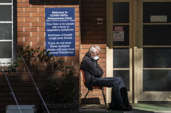 A person waits outside the COVID-19 Coronavirus Assessment Clinic at Prince of Wales Hospital on March 18.