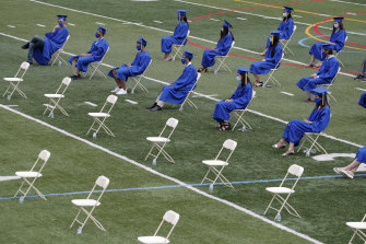 A socially distanced high school graduation in America.