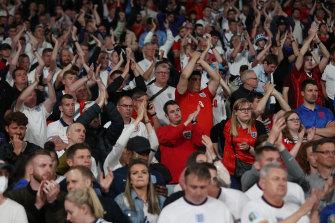 So close: England fans applaud their team despite the defeat.