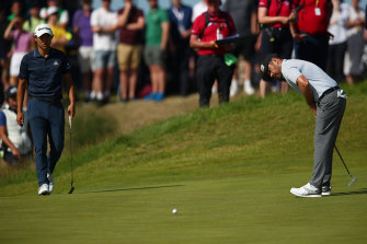 Louis Oosthuizen reacts to a putt on the fifth as Collin Morikawa looks on.