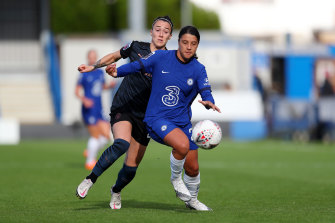 Chelsea's Sam Kerr holds off City's Lucy Bronze at Kingsmeadow on Sunday.
