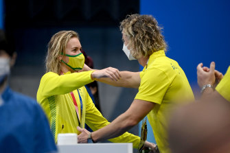Ariarne Titmus and Dean Boxall embrace after the Australian's memorable victory in the 400m freestyle final.