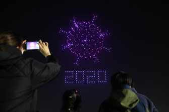 Drones fly over the Olympic Park make the shape of coronavirus to send messages to support the country and share measures to contain the spread of the coronavirus in Seoul, South Korea.