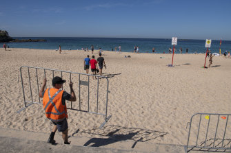 Barricades were set up to stop people congregating on the stairs at Coogee Beach on Tuesday.