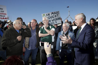 A man berates Deputy Prime Minister Michael McCormack as he meets with members of the farming community.