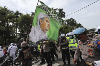 Hundreds of protesters marched in Jakarta on Friday December 18 to demand the release of the firebrand cleric who is in police custody on accusation of inciting people to breach pandemic restrictions.