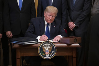 """Donald Trump described China's President Xi Jinping as a """"very, very good friend of mine"""" as he signed the trade deal."""