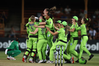 The Thunder celebrate victory at North Sydney Oval after Heather Knight's six.