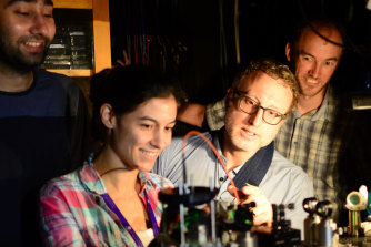 Warwick Bowen (middle right) with UQ researchers Waleed Muhammad, Caxtere Casacio and Lars Madsen aligning the quantum microscope.