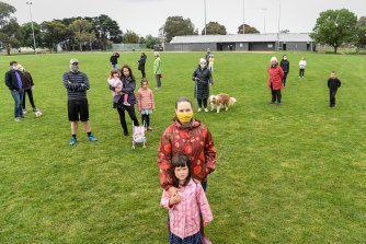 Tatiana Stephens and daughter Elfie with unhappy locals at Hosken Reserve.