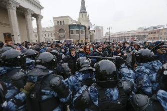 People clash with police In Moscow during a protest against the jailing of opposition leader Alexei Navalny held earlier in the year.
